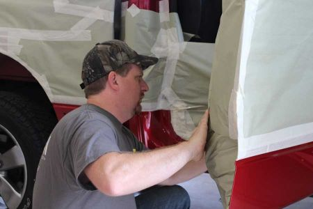 <h5>1. Mask Truck</h5> <p>On a clean, dry truck, the bed is masked as if it is to be painted. The entire truck is covered to protect from overspray.</p>