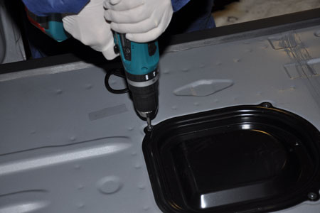 <h5>1. Remove Fittings and Mask Van</h5> <p>On a clean, dry truck, the bed is masked as if it is to be painted. The entire truck is covered to protect from overspray.</p>